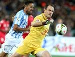Adelaide United goalkeeper Eugene Galekovic clears the ball against Malaga at Adelaide Oval. Picture: Sarah Reed.
