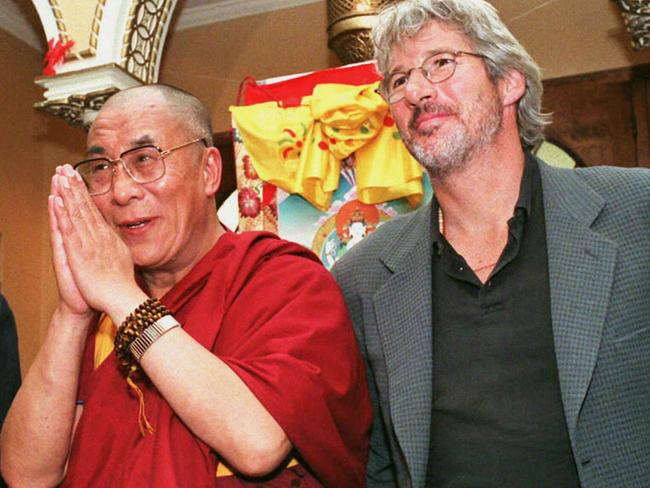 Dalai Lama stands with Richard Gere at Chicago's Medinah Temple in 1996.