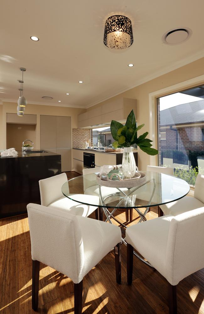 The inside dining area and kitchen are flooded with natural light. Picture: John Fotiadis