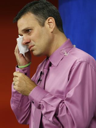 WDBJ-TV7 meteorologist Leo Hirsbrunner wipes his eyes prior to the early morning newscast. Picture: AP Photo/Steve Helber