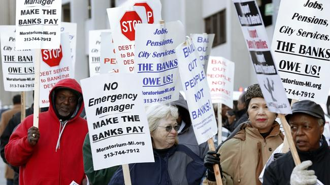 Protesters rally outside the courthouse. Picture: AP.