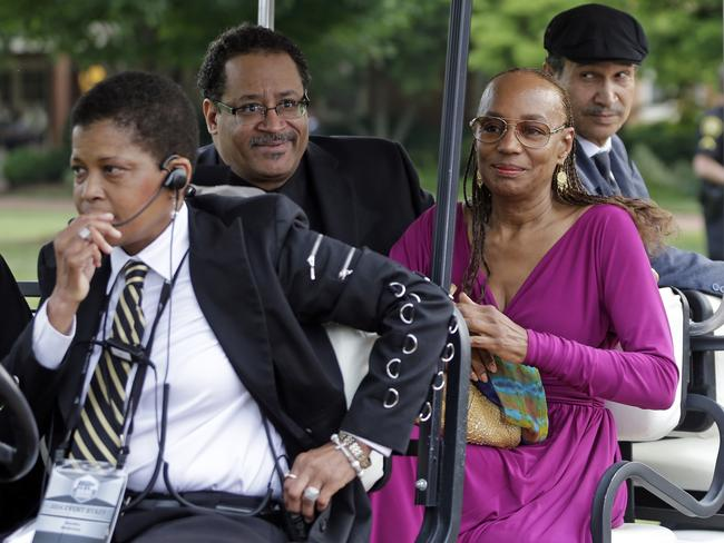 Respects ... Michael Eric Dyson, second from left, and Susan L Taylor, second from right, arrive to a memorial service for poet and author Maya Angelou at Wake Forest University in North Carolina. Picture: Chuck Burton
