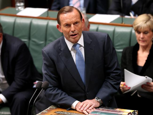Still pushing for the scheme ... PM Tony Abbott in Question Time in the House of Representatives. Picture: Kym Smith