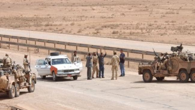 At the forefront ... Australian SAS troops stopped and searched dozens of vehicles travelling Highway One between Jordan and Baghdad during the Iraq war. Picture: SAS.