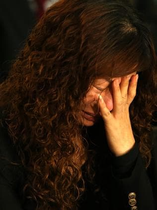 Mei Zhang weeps at a Sydney press conference.