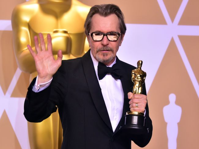 Gary Oldman took home the Best Actor trophy for his performance in Darkest Hour. Photo: AFP