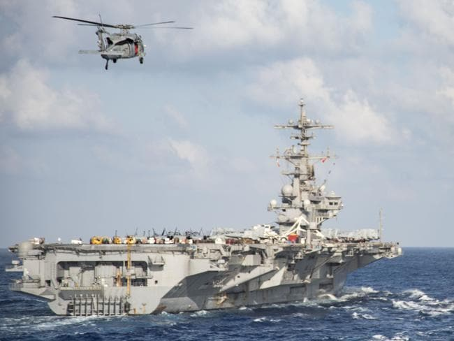 An anti-submarine MH-60S Sea Hawk helicopter from the aircraft carrier USS George H.W. Bush (CVN 77) during a replenishment-at-sea in the Mediterranean Sea on June 21. It is likely to have been involved in the hunt for Krasnodar. Picture: US NAVY