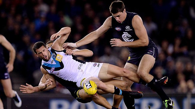 Port Adelaide skipper Travis Boak is brought down in a tackle. Picture: Colleen Petch
