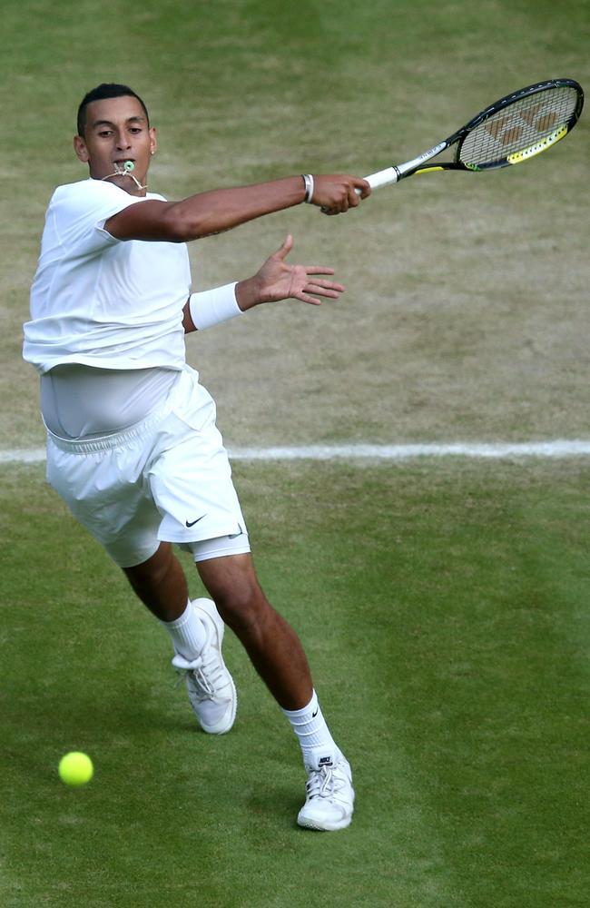 Australia's Nick Kyrgios slams a massive forehand against Rafael Nadal.