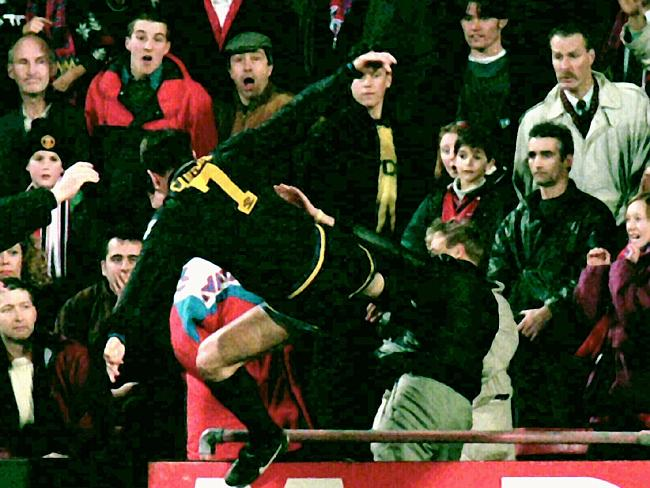 Manchester United's Eric Cantona kicks a Crystal Palace fan at Selhurst Park.