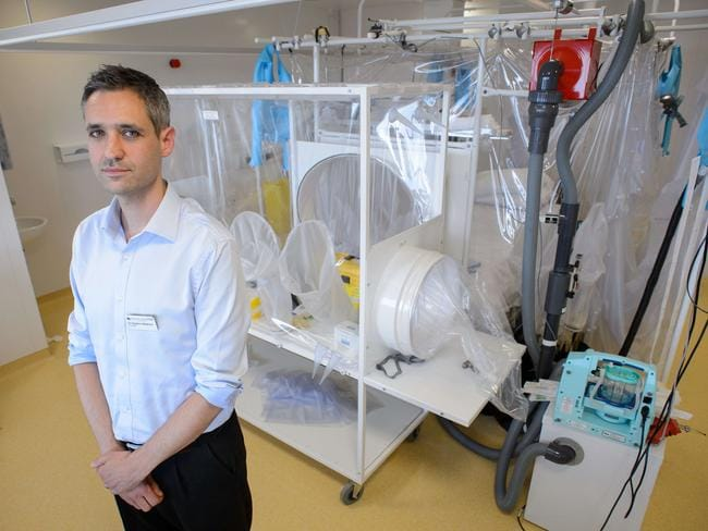 Doctor Stephen Mepham at the Royal Free Hospital in London preparing to test a patient for the virus. Pic: AFP.