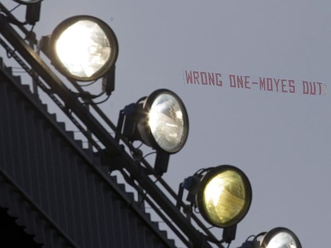 'Wrong One — Moyes Out' ... a banner critical of manager David Moyes is flown above Old T