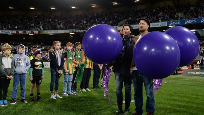 Anthony Maslin and Rin Norris prepare to release tribute balloons as friends of their children form a guard of honour. Picture: Daniel Wilkins