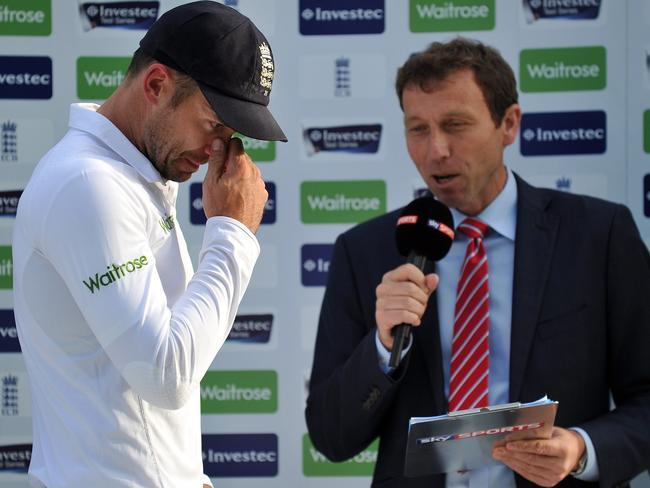 England's James Anderson (L) is reduced to tears during an interview following the loss.