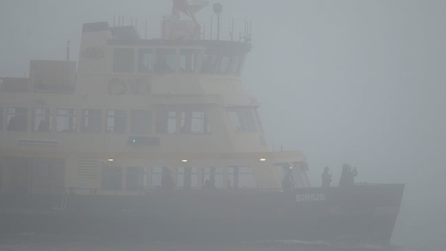 A thick Pea Soup fog descends on Sydney Harbour.