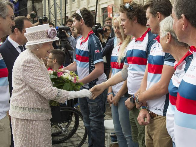 Local heroes... Queen Elizabeth II meets triple amputee Josh Boggi of Help For Heroes during her walkabout in Paris. Picture: Arthur Edwards