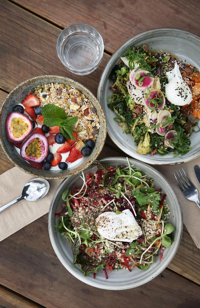 The raw breakfast plate, maple toasted muesli and farm green with an egg at the Three Blue Ducks in Ewingsdale, Byron Bay. Picture: Dylan Robinson