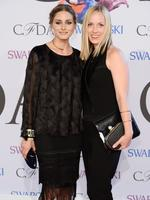 Olivia Palermo and Lisa Axelson attend the 2014 CFDA fashion awards at Alice Tully Hall, Lincoln Center on June 2, 2014 in New York City. Dimitrios Kambouris/Getty Images/AFP