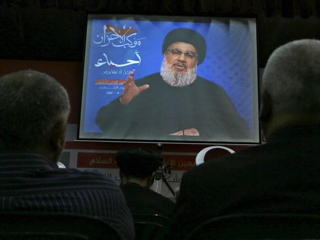 Hezbollah leader Sheik Hassan Nasrallah, speaks via a video link, during a rally marking Hezbollah Martyr's Day, in a southern suburb of Beirut, Lebanon, Friday, Nov. 10, 2017. Picture: AP.