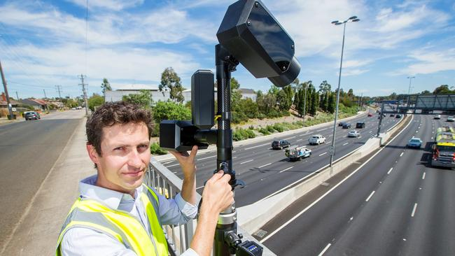 Alex McCredie demonstrates how the hi-tech cameras that can detect drivers using mobile phones work. Picture: Mark Stewart.