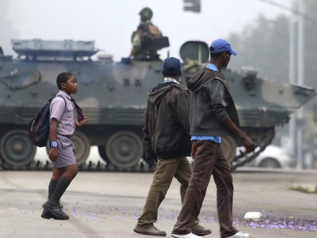 An armed soldier patrols a street in Harare after the country's military took control. Picture: AP