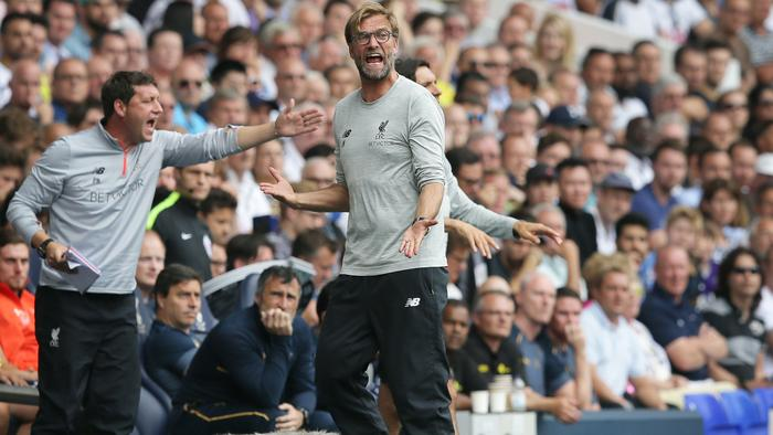 Liverpool manager Jurgen Klopp, centre, shouts across the pitch during the English Premier League soccer match between Tottenham Hotspur and Liverpool at White Hart Lane in London, Saturday, Aug. 27, 2016. (AP Photo/Tim Ireland)