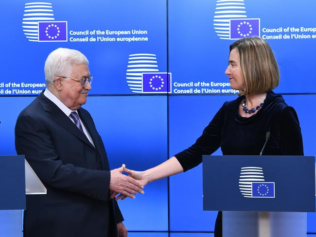 Palestinian President Mahmud Abbas is welcomed by EU foreign policy chief Federica Mogherini in Brussels. Picture: AFP/Emmanuel Dunand
