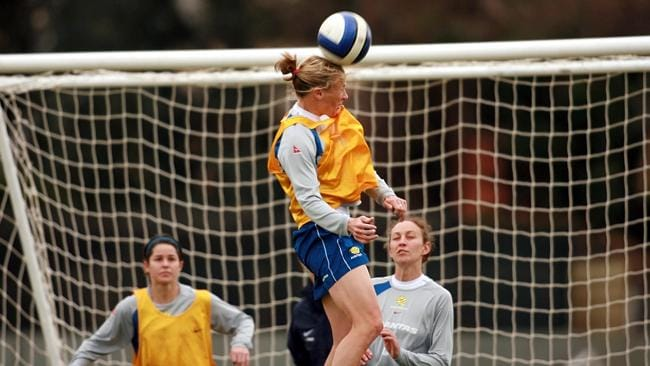 Joey Peters heads the ball at Matildas training…