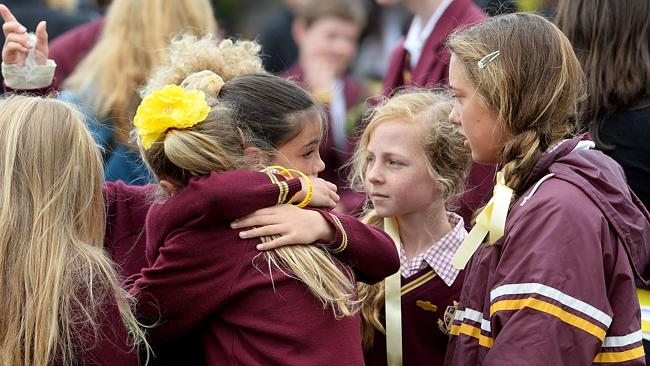 Flinders Christian Community College students comfort each other after the service.