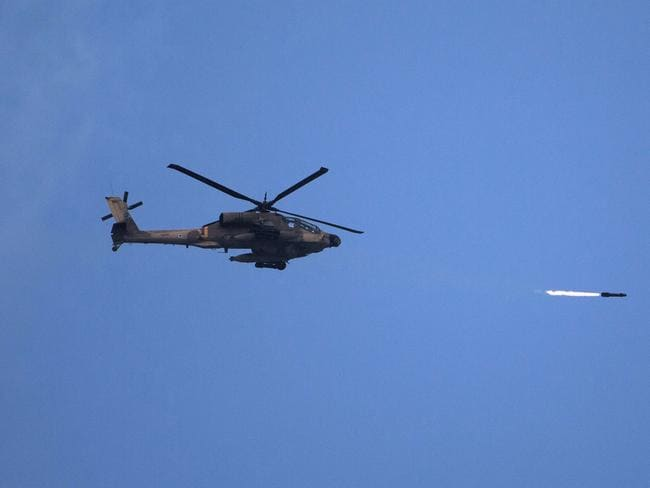By air ... An Israeli Apache attack helicopter shoots a missile over the Gaza strip.