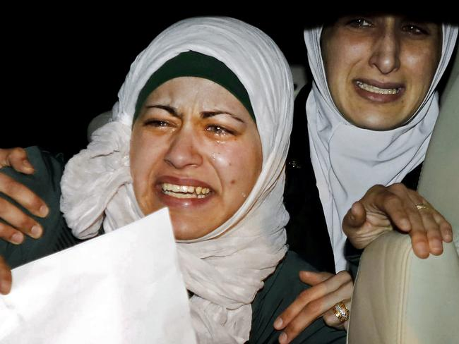 Heartbreak ... the sister, right, and wife, left, of Jordanian pilot, Lt. Muath al-Kaseasbeh, cry during a protest in front of the Royal Palace in Amman, Jordan, on January 28. Picture: AP Photo/Raad Adayleh