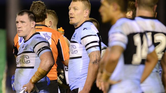 Paul Gallen and his teammates look dejected against the Sea Eagles.