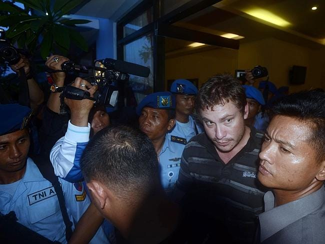 unwell and in need of help ... Matt Christopher Lockley when he was arrested by Indonesian police officers after landing. Picture: Sonny Tumbelaka