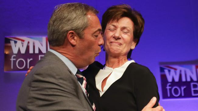 Awks: UKIP's Diane James and Nigel Farage embrace on her election as the party's new leader. Ms James lasted 18 days in the role. Picture: Daniel Leal-Olivas/AFP