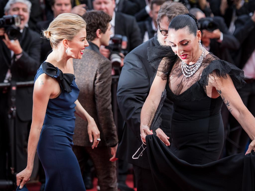 Sienna Miller and Rossy de Palma speak with each other upon arrival at the opening ceremony and premiere of 'La Tete Haute' ('Standing Tall') during the 2015 Cannes Film Festival. Picture: AP
