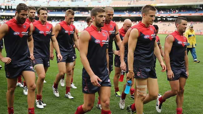 Jack Grimes leads the Demons from the field after losing the round one AFL match between the Melbourne Demons and Port Adelaide Power at the Melbourne Cricket Ground on March 31, 2013 in Melbourne, Australia. (Photo by Scott Barbour/Getty Images)