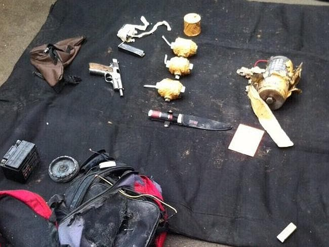 A backpack, handgun, knife and improvised explosives recovered from the scene of the terr