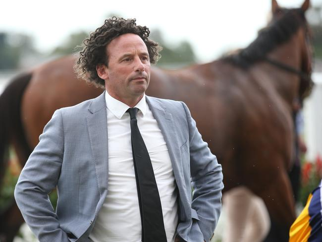 Let's get this party started: Trainer Simon Zahra after one of his stable stars, Booker, won the Kevin Hayes Stakes this month. Picture: AAP