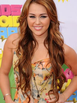 Miley Cyrus back in 2011, before she was covered in tattoos. Picture: Jason Merritt/Getty Images