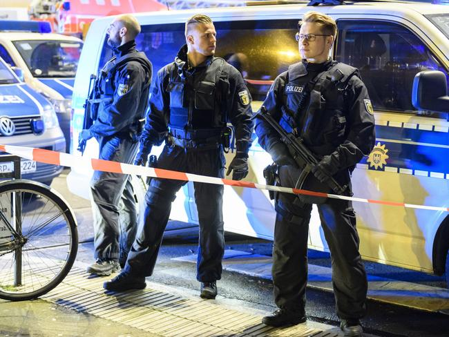 Heavily-armed police secure the perimeter of the train station after the rampage. Picture: Alexander Scheuber/Getty Images.