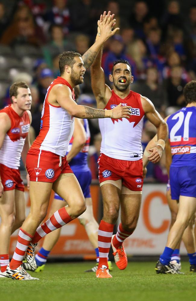 Franklin and Goodes after kicking a goal yesterday.