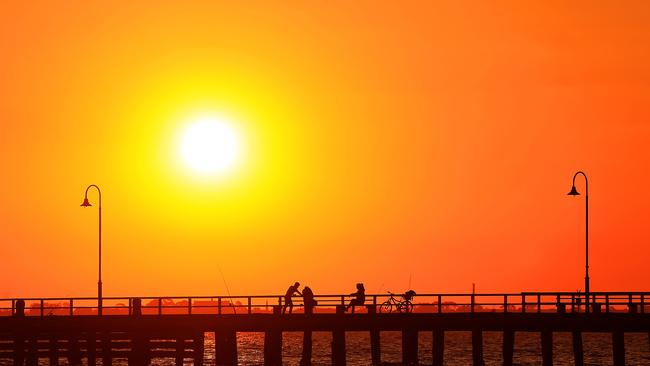 The sun sets at Middle Park beach ahead of several days of hot weather. Picture: Mark Stewart