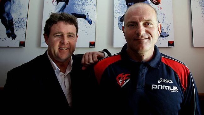 The AFL investigation has centred on comments made in a Demons football department meeting run by football operations manager Chris Connolly, pictured with Dean Bailey, allegedly reminding staff about the importance of the extra draft pick. Picture: Colleen Petch