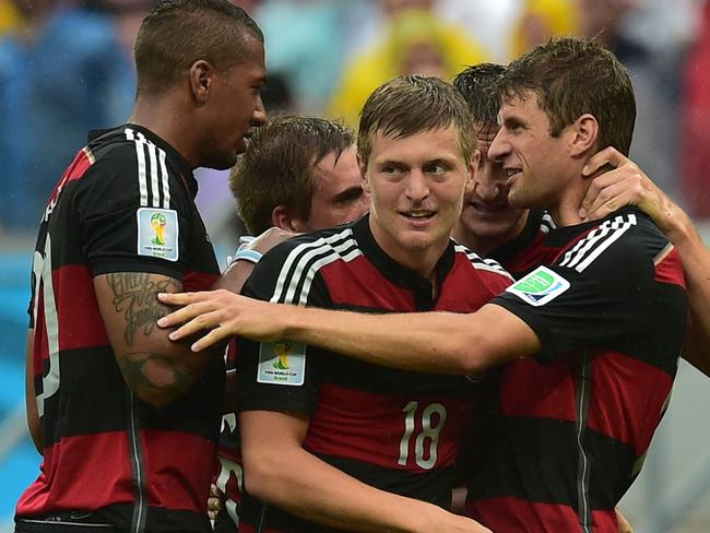 The Germans celebrate their winning goal against the USA.