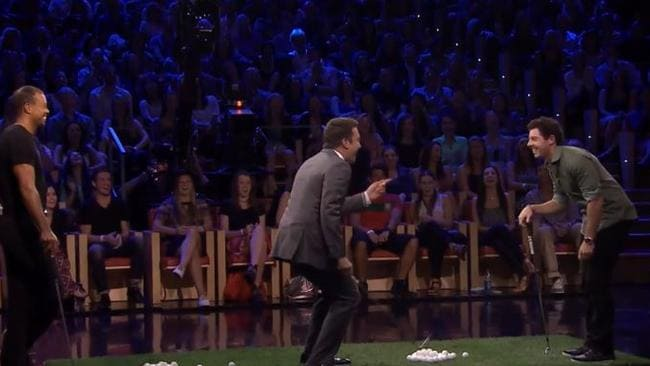 Tiger Woods, Jimmy Fallon and Rory McIlroy share a laugh playing, Facebreakers.