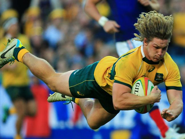 Michael Hooper flies gracefully through the air.
