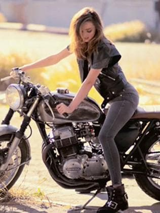 Kerr straddles a motorbike during a shoot for Net-a-Porter. Picture: Net-a-Porter