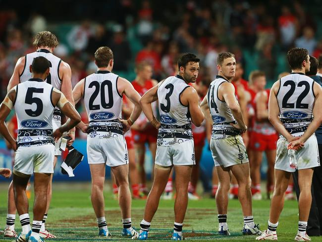 Dejected Cats players including Jimmy Bartel (no. 3) and Joel Selwood (2nd from R) after their 110 point loss. Picture: Toby Zerna