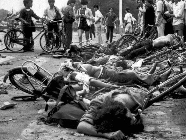 Lost women and men ... bodies lying among mangled bicycles near Beijing's Tiananmen Square after massacre by Army of hundreds of pro-demoncracy protestors in 1989.