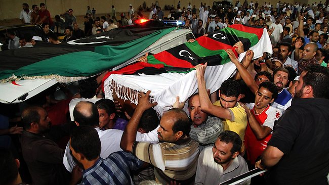 The coffin of Omran Ben Shabaan is carried as thousands of Misrata residents pay their respects during his funeral at Misrata stadium in Misrata, Libya. AFP PHOTO/STRINGER